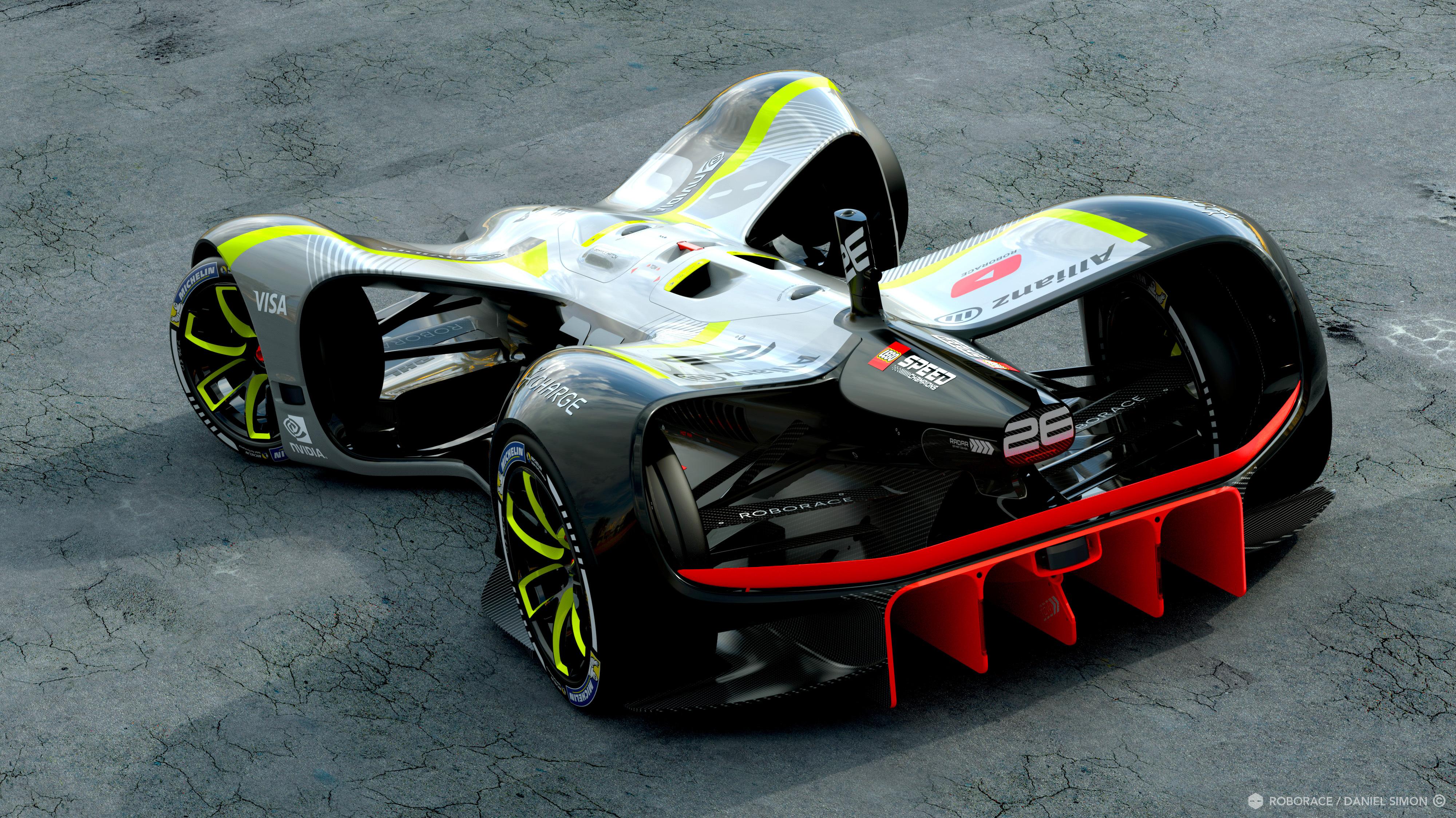 Een blik op de achterkant toont duidelijk dat de aerodynamica zeer goed is uitgewerkt. Makkelijker ook als geen coureursplaats nodig is. Middenop luchtuitlaten van de koeling voor de processor, die daarvoor ligt.